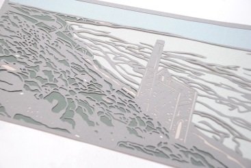 Papercut depicting Cornish coastline