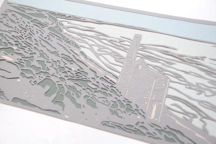 Papercut depicting Cornish coastline